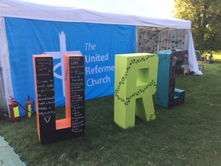 Image of blocks spelling URC at Greenbelt festival