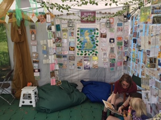 Image of postcards display in tent at Greenbelt festival