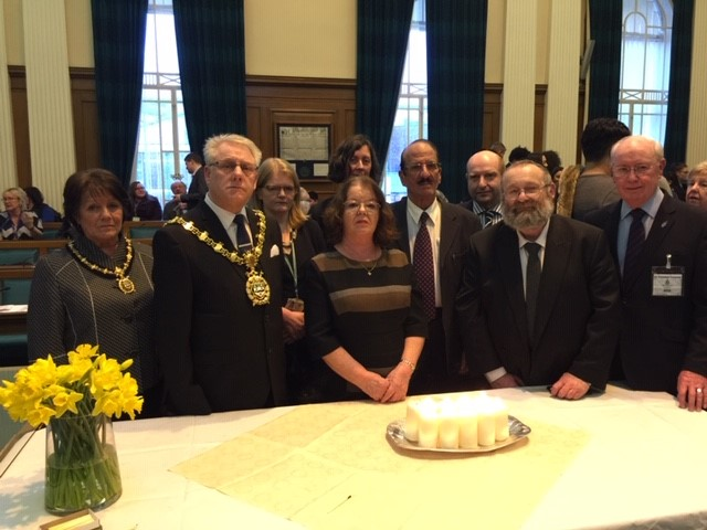 image of local mayor, leader and chief executive of the town's council, the local member of parliament, a local rabbi, representatives of the town's interfaith forum and young people from local schools across the town.
