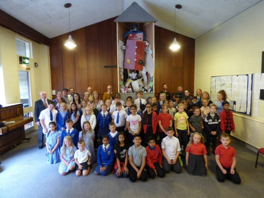 Pictured: Children at Westbury Gardens United Reformed Church, Lancashire, celebrate the creation of their 'rubbish monster'